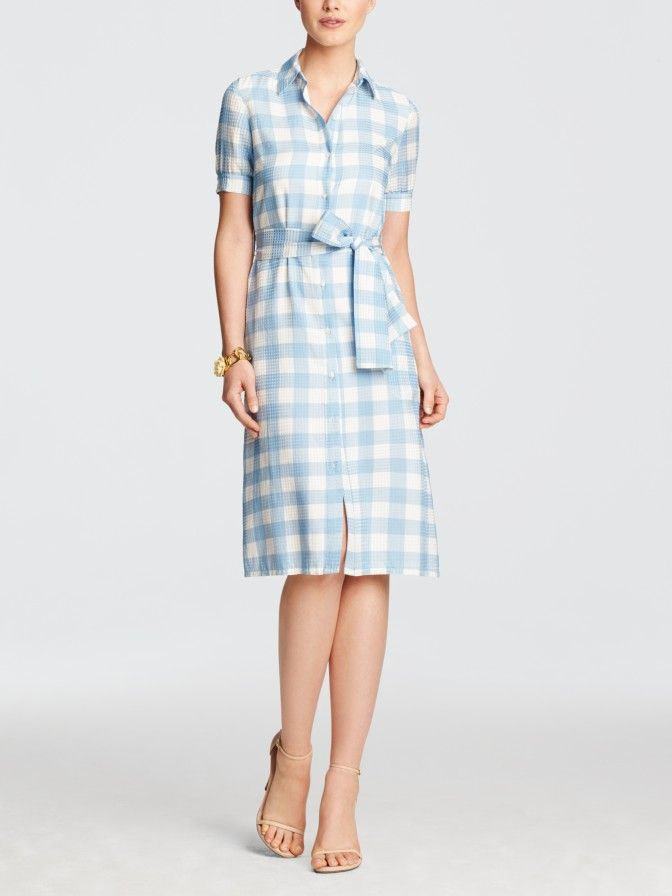 We've added a serious dose of feminine glamour to the classic shirtdress. Our Midi Shirtdress is done in luxe silk printed with our Parton check and has added length for an elongating effect. Cinch the self-belt, throw on a pair of short cowboy boots, and you're good to go from morning 'til cocktail hour.