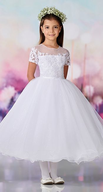 21262ec94ab6a Satin, tulle, sequin tulle and lace tea-length full A-line dress with short  sleeves, a hand beaded jewel illusion neckline trimmed with pearls, ...