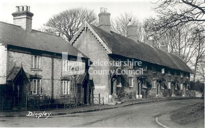 Church Lane, Dingley, around 1910. This image is a copy photograph of a postcard showing a row of stone and thatch cottages in Church Lane, which belonged to the Dingley Hall estate.   Dingley lies 3 miles to the east of Market Harborough. Note the unusual angle at which some of the chimney pots are set. Dingley is the home to the annual Fernie point to point horse race that raises funds for the Fernie Hunt.
