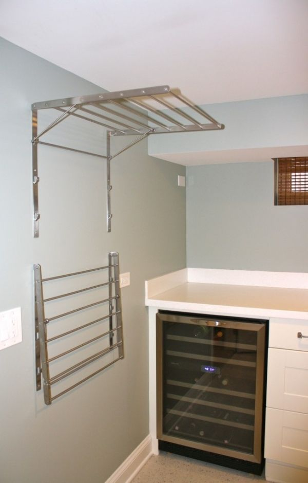 Ikea Grundtal drying racks--laundry room must-have... wonder if the wine fridge comes with it? by jewel