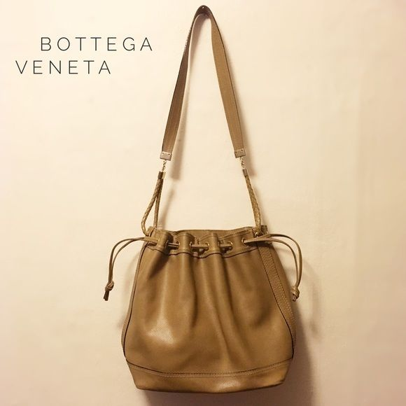 Vintage olive crossbody bucket bag Authentic Bottega Veneta embossed leather purse in olive with gold detailing. There are some scratches on the exterior and the inside leather is peeling (see pics)--I'm sure there's a way to fix that interior though! But I've listed it at this low price because of it. The bag is 12 inches tall and 16 long at the largest point, and 6 wide. The zipper and draw string are in perfect working order. Please message me if you have any questions! Bottega Veneta…
