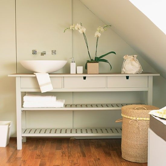 Console table from IKEA makes an inexpensive storage unit for the bathroom.