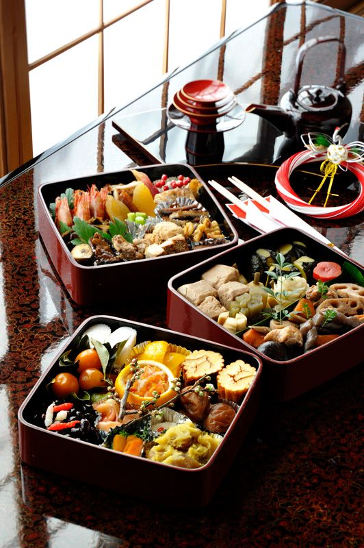 Osechi: Japanese foods prepared for New Year's. Favorites include datemaki (egg and fish cakes), kombumaki, ikura (salmon eggs) in yuzu container, kazunoko, grilled buri (yellowtail) and kuromame (black beans.)