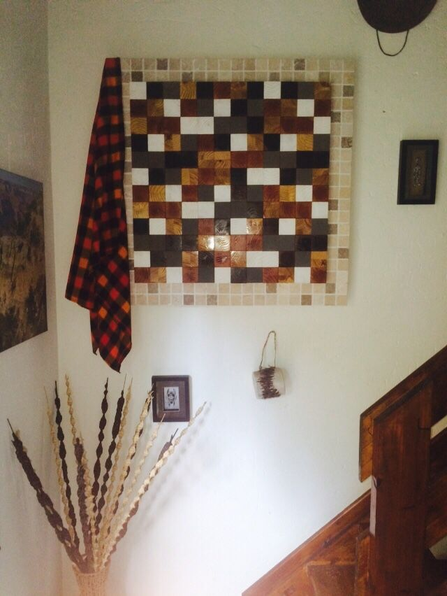 Wooden Mosaic with 5 different colors finished off with a tiled border