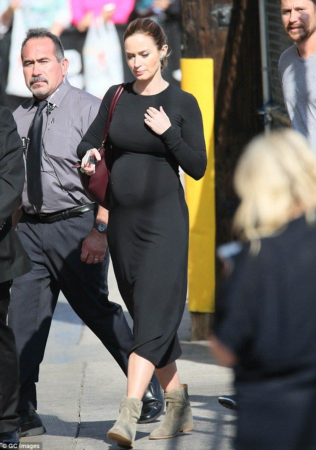 Hot mama-to-be! Emily Bluntput her bump on display in a clinging black maxi dress as she ...