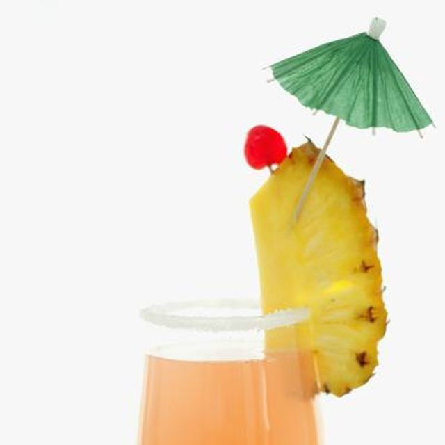 Most mai tai drinks are garnished with a pineapple slice and an umbrella.