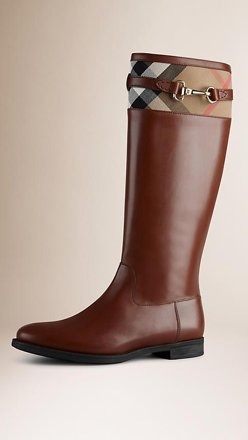 Burberry Refined leather riding boots with a House check panel. The design features a distinctive buckle detail and a practical rubber grip sole. The boots are cut for a loose fit on the leg. Discover the shoes collection at Burberry.
