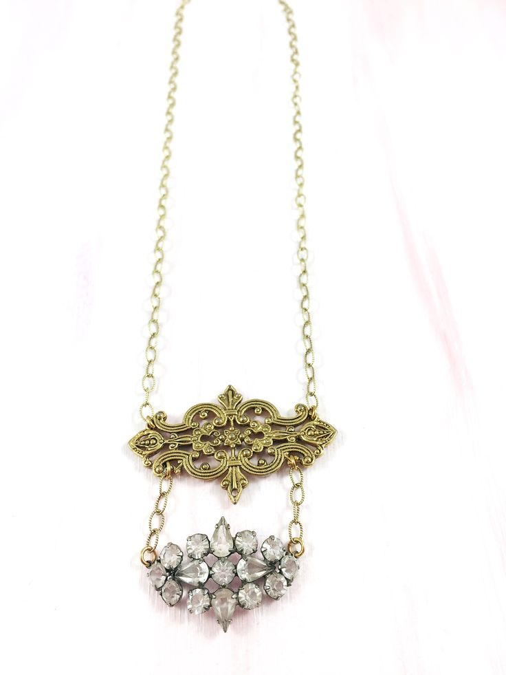 """""""The Shining Path"""" - 1940's rhinestone brooch paired with a 1960's gold medallion on delicate etched brass chain"""