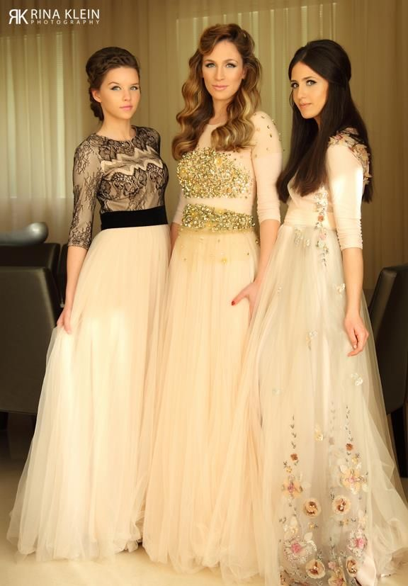 Love the dress to the left and right! Not nuts about the one in the middle