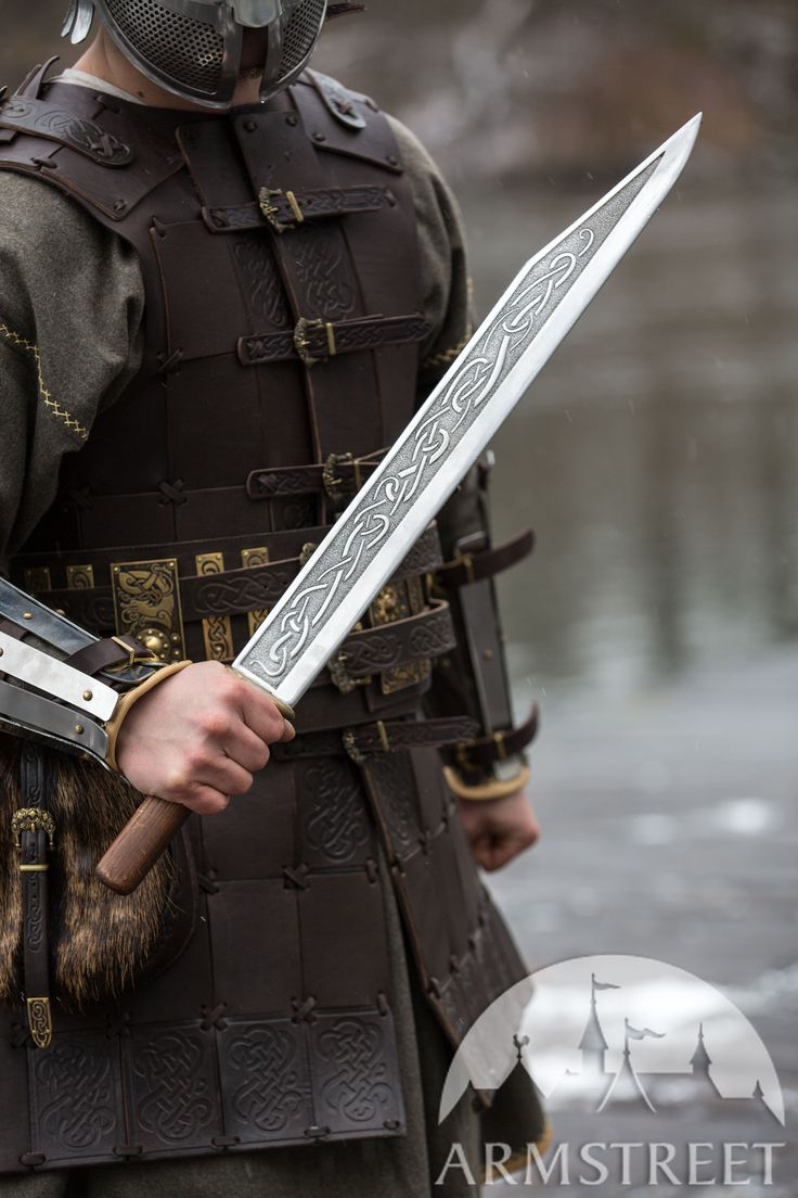 Stainless steel seax with etching and embossed scabbard