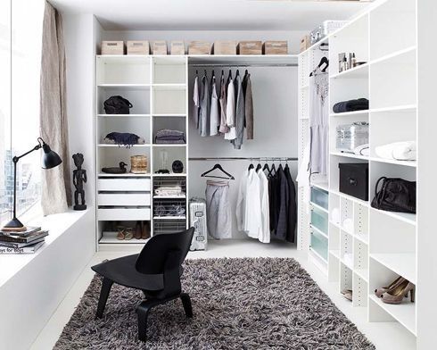 White walk in closet wardrobe with home office