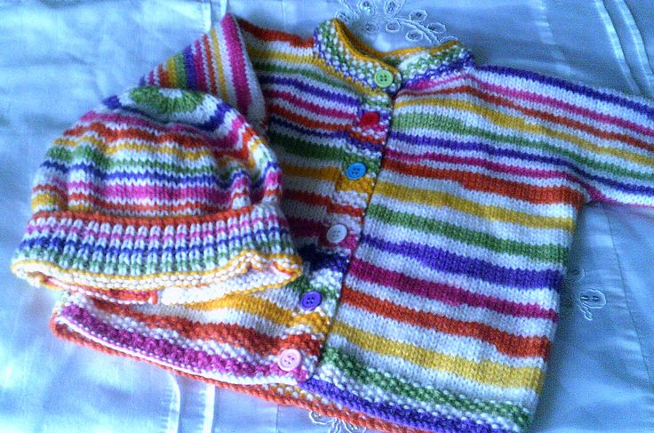 Multi coloured cardigan with matching hat. Size 0 - 1 year.