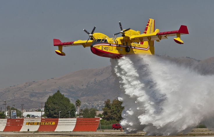 STRANGE FIRE FIGHTING AIRCRAFT - CANADIAN AIR SUPERSCOOPER CL415T - DROPPING WATER