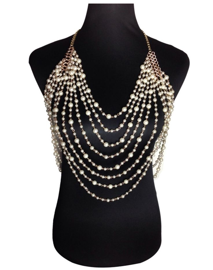 Drape your body with these beautiful layers of pearls. Multi layer gold chain necklace with white pearls. Necklace rapes in the front and back.