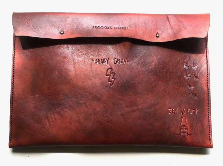 This deep brown cool custom tattoo leather laptop case will protect &  flatter any size laptop