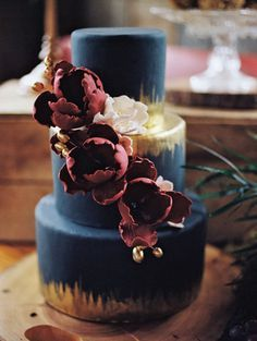 Unique, bold and dramatic wedding cake idea - navy fondant cake with metallic gold and marsala colored flowers
