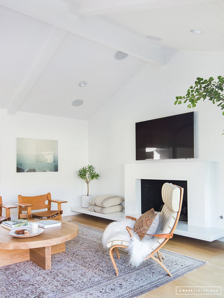Minimalist Mid-Century living space with grey rug