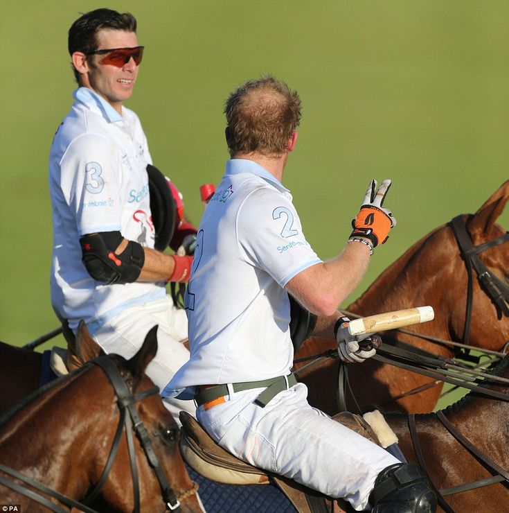 Twice unlucky: Prince Harry (front) gestures to a teammate after he fell off his horse twi...
