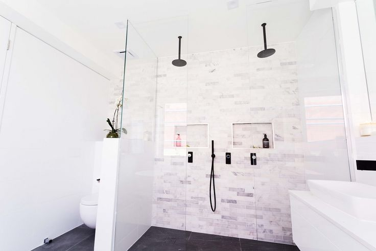This stylish bathroom from The Block features the Alpine Grigio Lappato, the Gloss White, and the Mos Calacatta Brick tiles from Beaumont Tiles. For more bathroom inspiration, check out http://www.beaumont-tiles.com.au/Room-Ideas/Ensuites