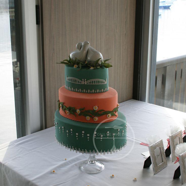 Russian themed oval wedding cake.