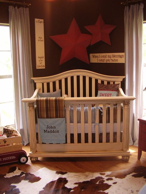 Love this westerny rustic Nursery and it wouldn't take but a few tweaks to make it for a Little Mister AND Missus :)