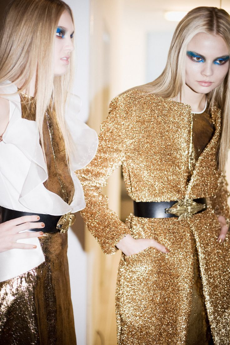 Queen Midas – prabal gurung fall winter 2012 collection, interview magazine, photographer shawn brackbill, backstage, metallic shimmer gold textured coat, sheer white ruffled top, black with gold detail waist belt