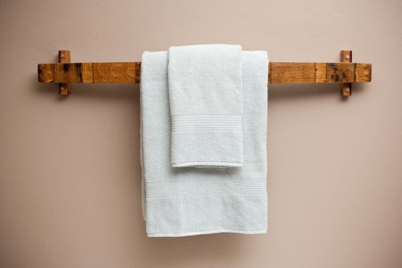 Driftwood instead of wine barrel stave. Hey, I found this really awesome Etsy listing at https://www.etsy.com/listing/109721938/barrel-stave-bath-towel-rack