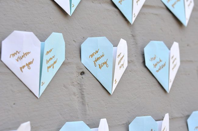 We love this fun + sweet idea for escort cards from the creative gals fromSmitten on Paper! So easy to make and you could change the colors to match your wedding day colors. The hearts could also make a sweet ceremony backdrop (with no words on them) covering an otherwise boring wall. So many ways...