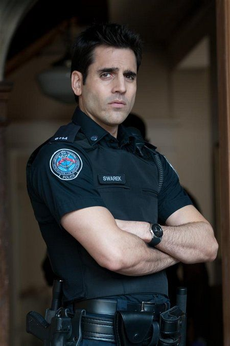 Sam Swarek on ROOKIE BLUE, played by Ben Bass. I like cops as heroes anyway, but this guy is yummy! I love it when he looks mean this way.