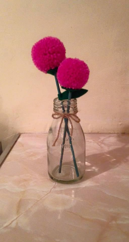 Deep pink pompom flowers in an ickle milk bottle https://www.facebook.com/AndiesAccessories/photos/a.1088836111143103.1073741890.251860708173985/1100888696604511/?type=3&theater