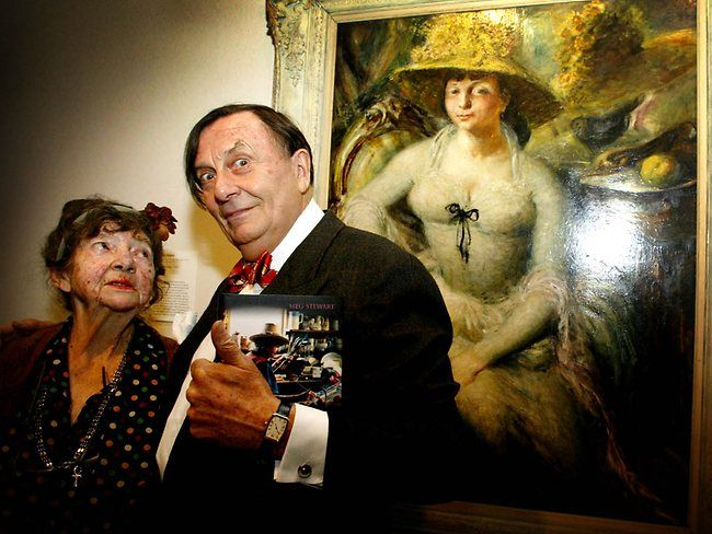 Margaret Olley and Barry Humphries in 2011, with the William Dobell portrait of a young Margaret