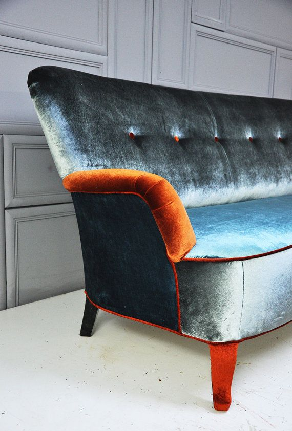 We love this blue velvet sofa, with a flash of vibrant orange. What a beautiful contrast.