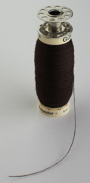 if I ever get a serger:  a cone bobbin hack.  She winds thread from a cone on to an empty spool of thread.