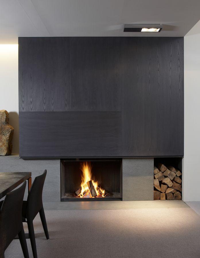 Fire place in dark wood veneer + Basaltina by De Puydt haarden