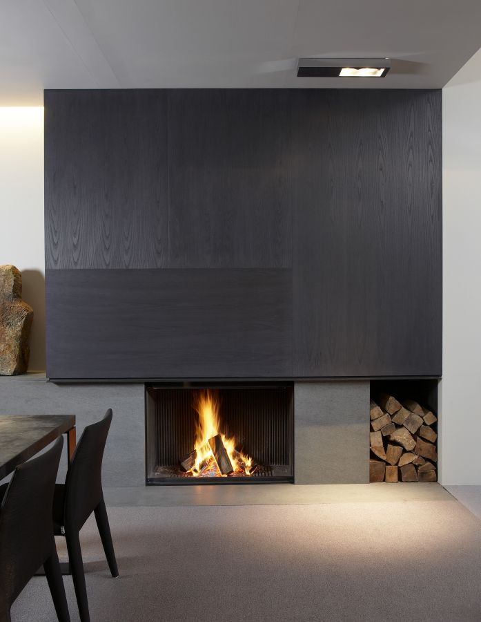 Fire place in dark wood veneer + Basaltina by De Puydt haarden