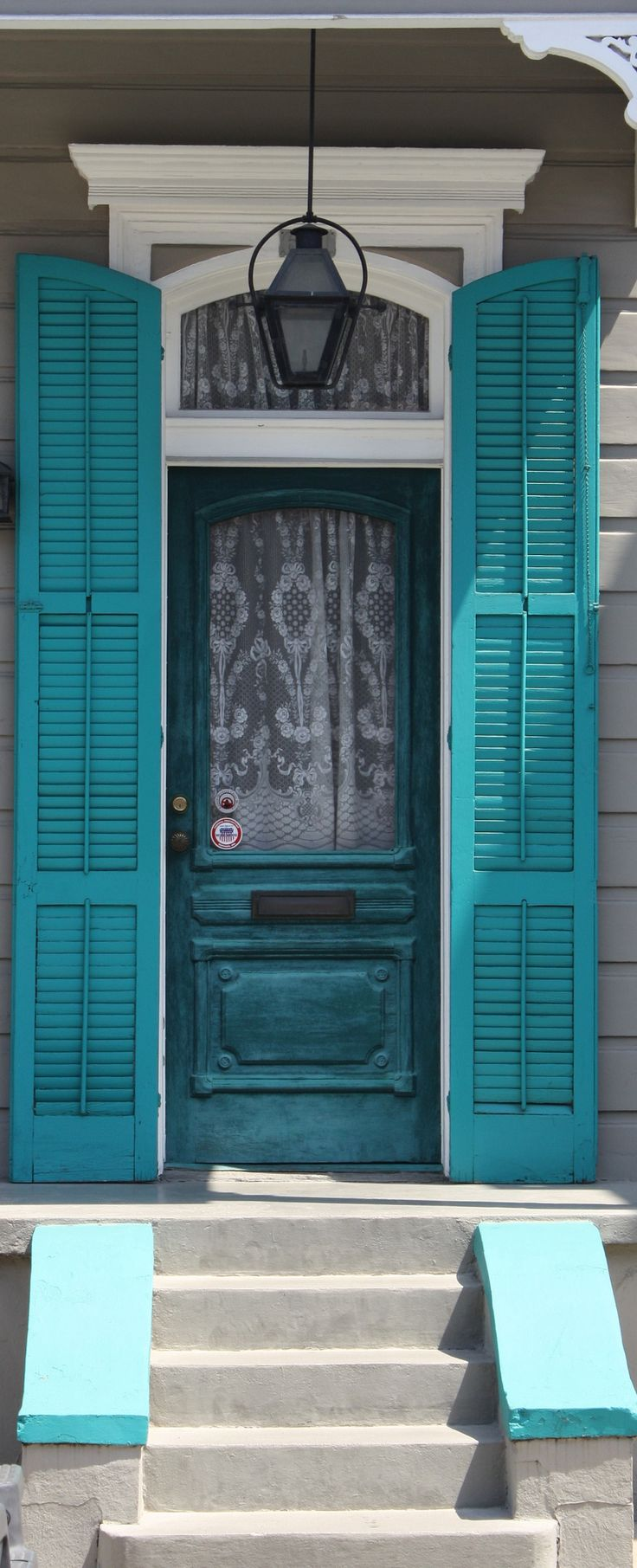 Lovely combination of soft grey siding/concrete, pristine white trim and turquoise front door with shutters | New Orleans, April 11, 2012 by gcl1964 via Flickr