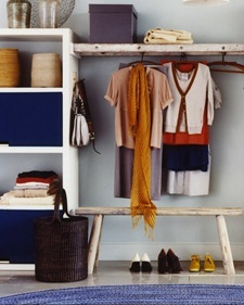 Dont have the space that a walk-in closet demands? Try building a walk-by. An old ladder bridges the gap between two basic shelving units and creates a homey space to hang clothes-a far cry from the typical sterile, stainless steel rod.
