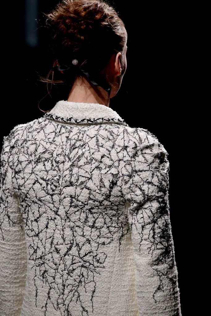 Jacket detail with embroidered cracked patterns; sewing ideas; couture embroidery // Chanel