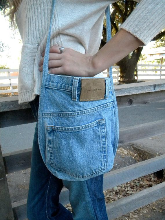 OOAK Hand Made Original recycled Calvin Klein Jeans denim bag is 9 1/2 wide. 11 tall and 2 1/2 inches deep. Original out side back pocket. Magnetic closure. This is truly an original one of a kind bag. There is one original outside pocket.. Easy care machine wash and dry.