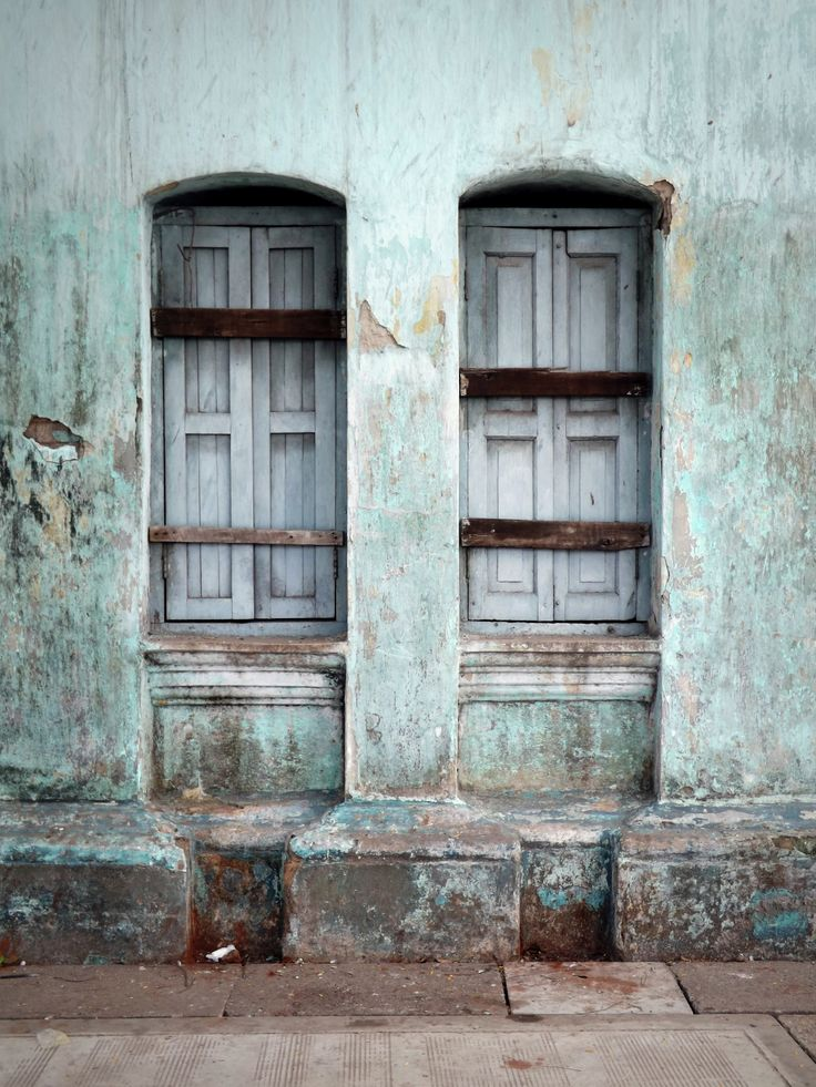 Boarded up windows in the old capital, Yangon. Battered, but calm amid the chaos of the streets.