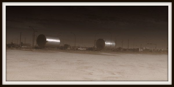 Big rigs hauling giant barrels for the oil patch.