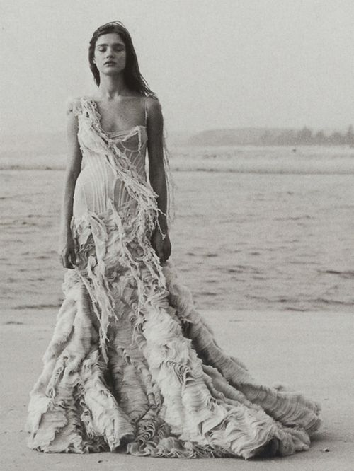 Natalia Vodianova in Alexander McQueen... Perfect mix of form-fitting, messy, ruffled, frayed.. kind of mermaid prom-queen.