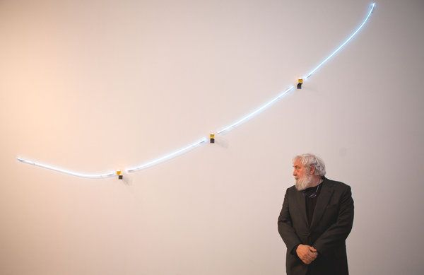 "Pier Paolo Calzolari, for whom two New York galleries will be as one, in front of ""Untitled."""