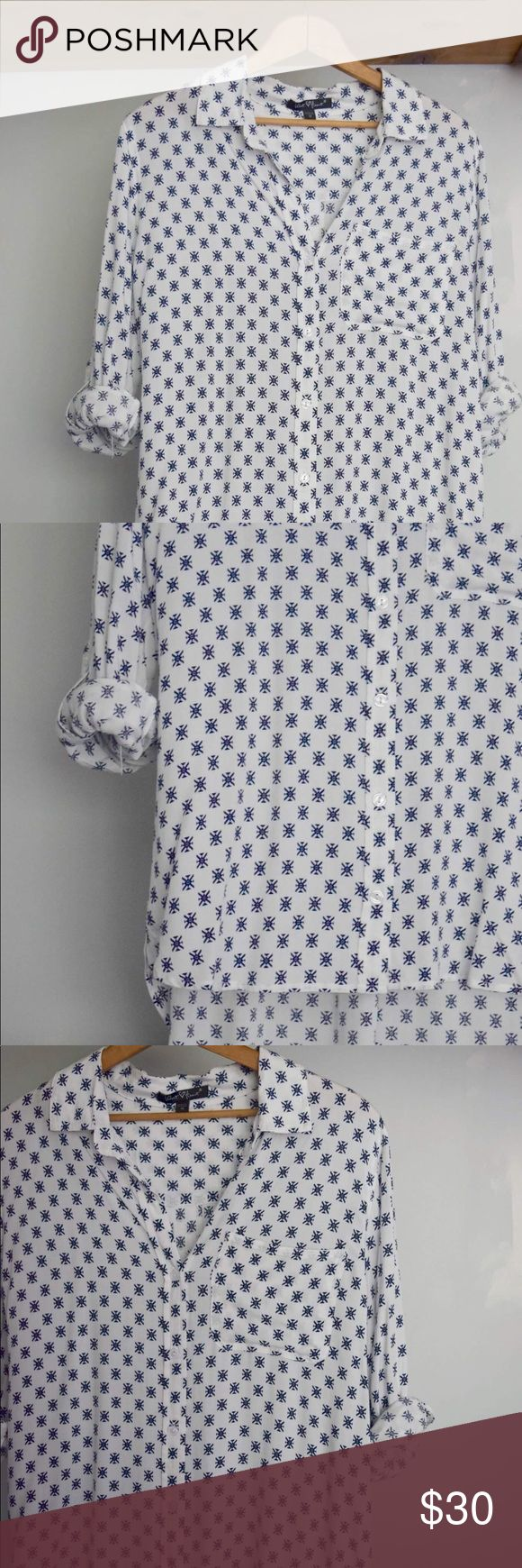 White and blue patterned blouse White and blue shirt with quarter sleeves.  I love that it's longer in the back!  Brand new. Never been worn! Valient Heart Tops