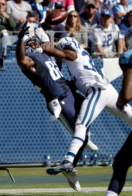 Colts vs. Titans  -  26-34, Colts:  October 23, 2016  -      Tennessee Titans tight end Delanie Walker (82) reaches for a pass as he is defended by Indianapolis Colts free safety T.J. Green (32) in the first half of an NFL football game Sunday, Oct. 23, 2016, in Nashville, Tenn. Green was called for pass interference on the play.
