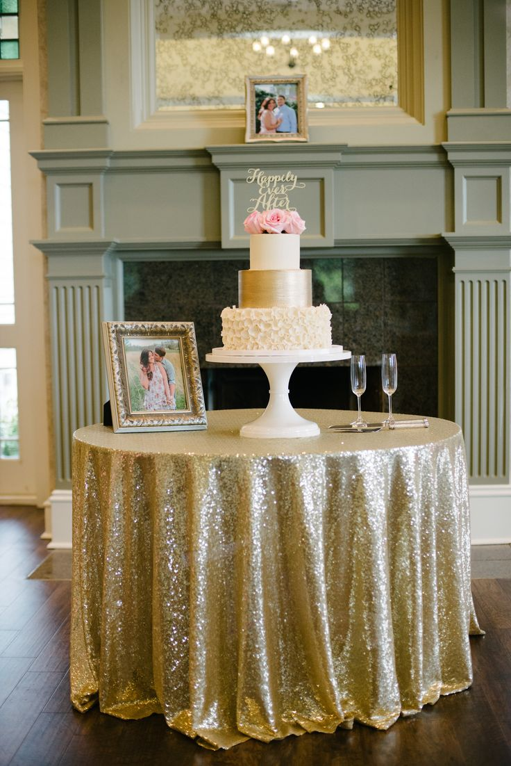 Beautiful wedding cake display on a sequined table cloth - Burritt on the Mountain, Huntsville, AL.