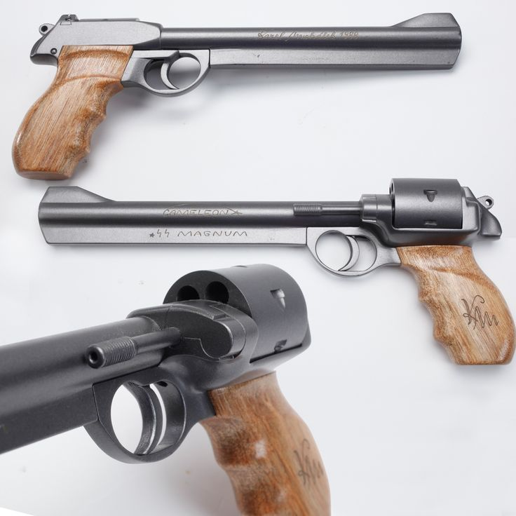 """Cameleon Pistol-When the revolutionary  wave in 1989 in Poland spread into Czechoslovakia in '92, Michalek decided to build his own using epoxy and wood to craft a line of unusual revolver models, Gaining some attention overseas, is """"Cameleon .44 Magnum"""" was a new look at a double-action handgun and was one of two designs that were sent to America for review by Ruger & Colt."""
