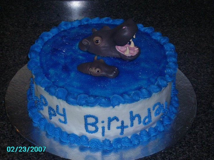 Hippo Cake - Animal Planet is the theme for this birthday cake.  All buttercream icing w/ tinted piping gel on top to look like water.  The mama and baby hippo were purchased off of birthdayexpress.com