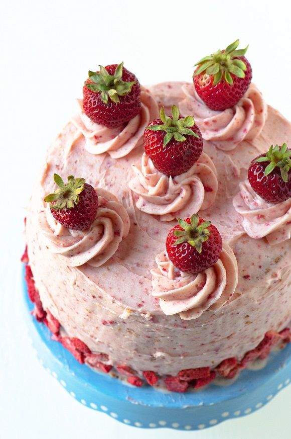 Strawberry Shortcake Layer Cake: Yellow cake with Strawberry Biscuit Buttercream (yes real pieces of biscuit in there) and fresh strawberries. All the great flavors of strawberry shortcake rolled into a layer cake. #sponsored