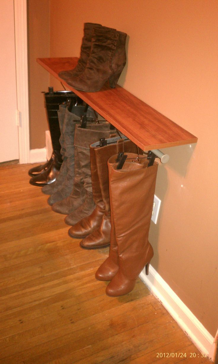 "Pinner said ""no space in my closet, made this shelf with hanging rod, cut down metal skirt hangers to fit to hang my boots - and since they're so pretty, they become decor in my bedroom :)"""